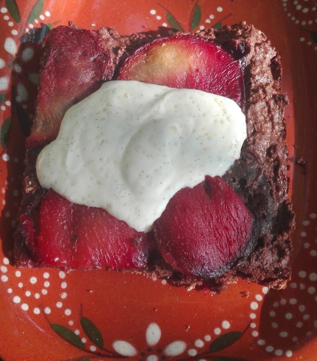 chocolate cake with plum and vanilla sauce